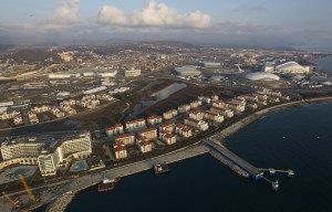 An aerial view from a helicopter shows the Olympic Park under construction and the Olympic Village in the Adler district of the Black Sea resort city of Sochi